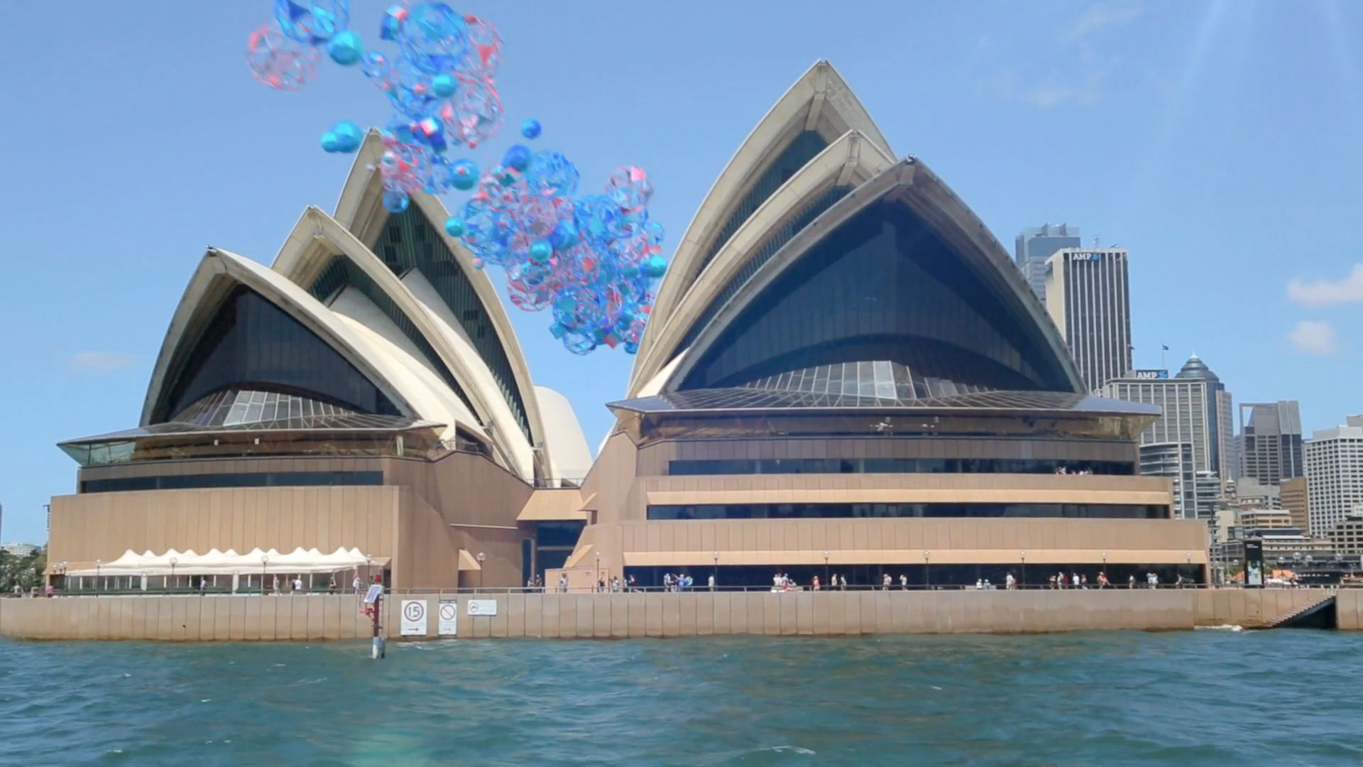 Live-action Sydney Opera House with motion graphics around it